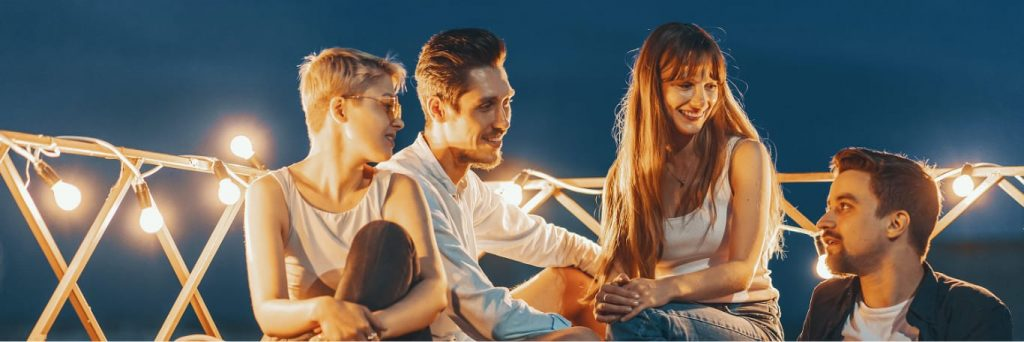 Friends on a rooftop background image.