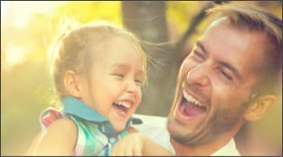 Father with happy daughter outside
